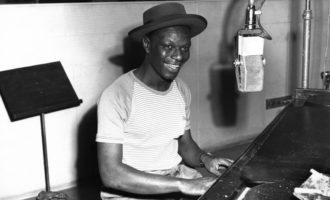 Nat King Cole playing piano in the Capitol Records recording studio on May 23, 1945.
